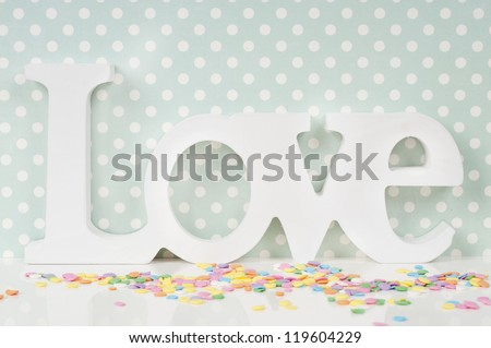 Wedding card design with love and cupcake sprinkles - stock photo