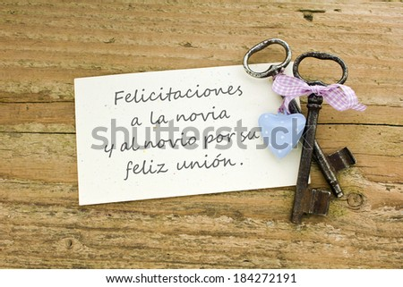 Wedding Card with two keys and heart/Congratulations to the bride and groom very much for the wedding./spanish - stock photo