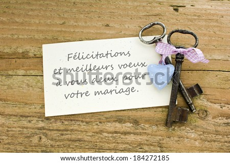 Wedding Card with two keys and heart/The very best wishes to the wedding, a lot of joy and happiness./french - stock photo