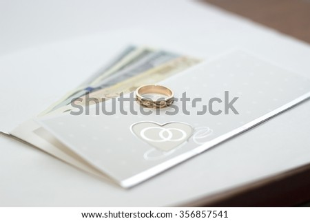 Wedding cards with money on the table - stock photo