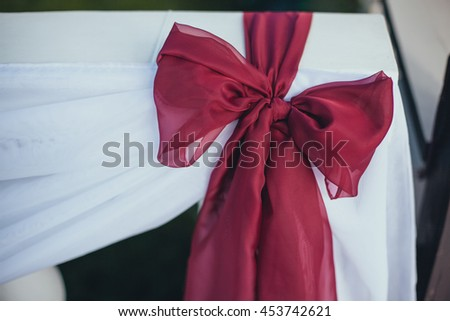 Wedding. Ceremony.Aisle to arch. Marsala tissue tapes decorate the arch for the wedding ceremony - stock photo