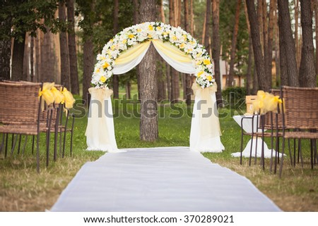 Wedding ceremony decoration in the garden - stock photo