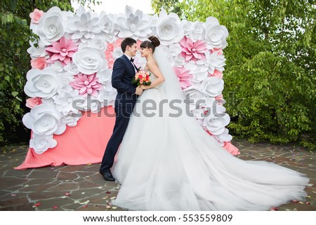 Wedding Ceremony Young And Beautiful Couple Near Arch With Paper Flower Decorations Happy