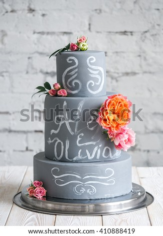 Wedding chalk cake decorated with flowers  - stock photo