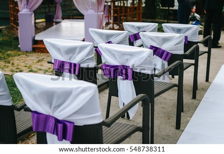 Superb Decorated Chairs With Purple Satin Ribbon.
