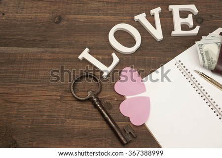 Wedding Concept Image. Hearts, Gold Pen,Vintage Key, Notepad With Blank Paper, Male Wallet With Dollar Cash On The Wood Background With Copy Space, Top View - stock photo