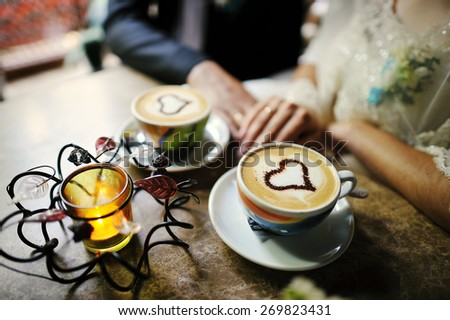 wedding couple and cup of coffee - stock photo