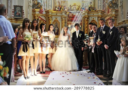 wedding couple  and groomsman with bridesmaid at the church - stock photo
