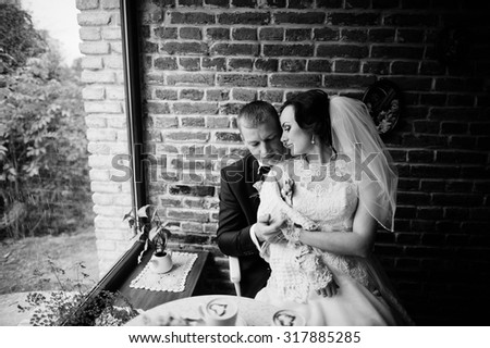 wedding couple at vintage cafe at autumn day