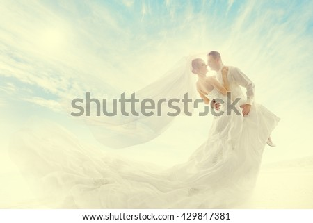 Wedding Couple, Bride and Groom Dancing in Dress with Veil - stock photo