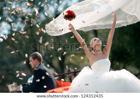 Wedding couple bride and groom in nature. The bride throws up veil. - stock photo