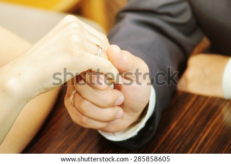Wedding couple holding hands in wedding day - stock photo
