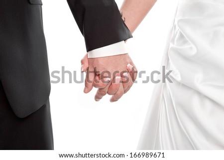 Wedding couple holding Hands isolated on white - stock photo