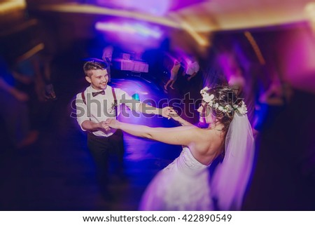 wedding couple in a restaurant celebrating her wedding day - stock photo