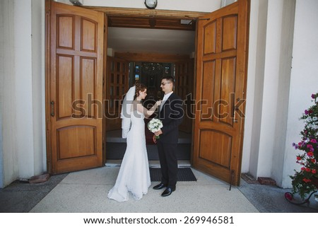 Wedding couple in church for the ceremony - stock photo