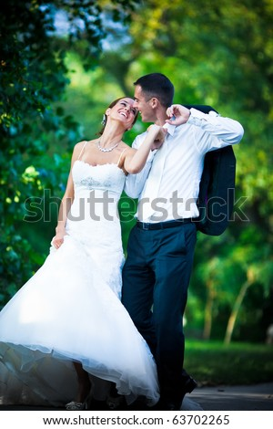 Wedding couple in love injoying together in nature and smiling - stock photo