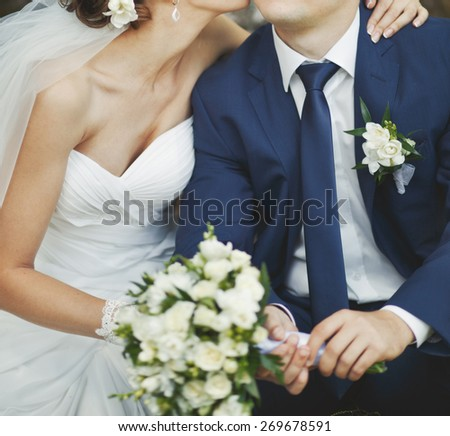 Wedding couple in love sitting together.