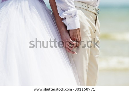 Wedding couple in Taisky style, Taisky architecture, a loving couple, wedding suits - stock photo