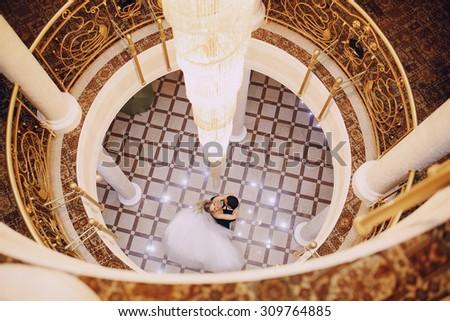 Wedding couple in the elegant interior of the hotel - stock photo