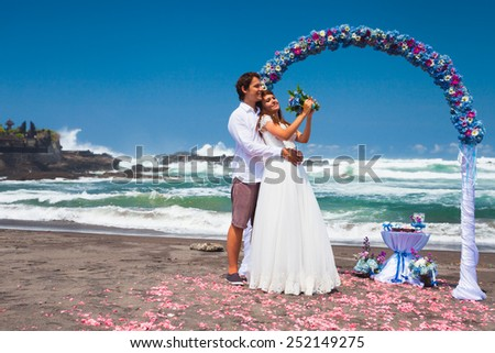 wedding couple just married near the beach at Bali - stock photo