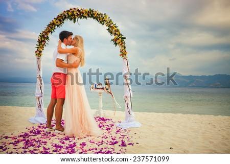 wedding couple just married near the beach at Gili meno - stock photo