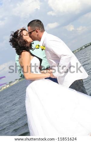 Wedding couple kiss - stock photo