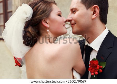 wedding couple looking at each other - stock photo