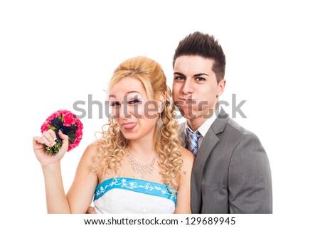 Wedding couple making funny faces, isolated on white background. - stock photo