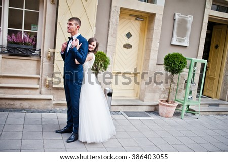 Wedding couple near vintage building