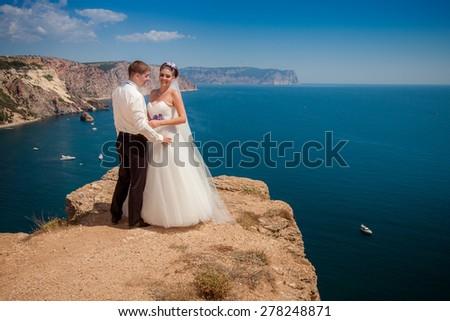 Wedding couple on sea background - stock photo