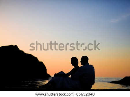 wedding couple on the beach at sunrise time - stock photo