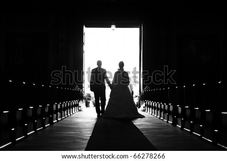 Wedding couple out of church - stock photo