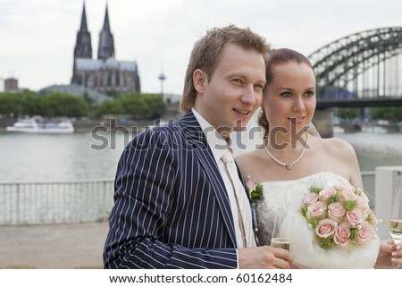wedding couple outdoor - cologne cathedral in background - stock photo