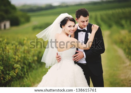 wedding couple, outdoor portrait - stock photo