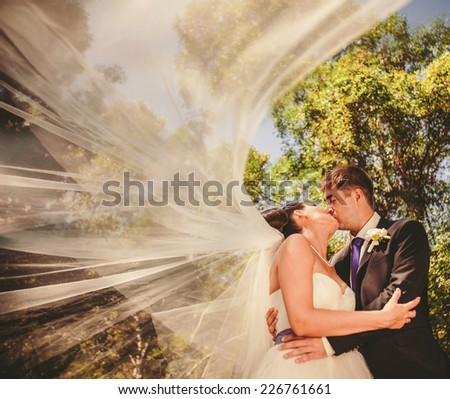 Wedding couple outdoors - stock photo