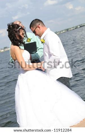 wedding couple praying - stock photo