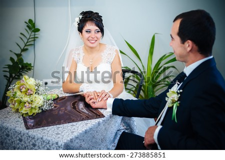 wedding couple sitting in a cafe on their wedding day.