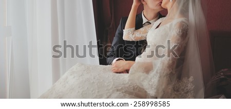 Wedding couple together in hotel room.