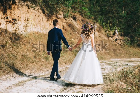 Wedding couple walking - stock photo