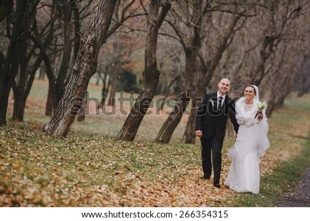Wedding couple walking in the park
