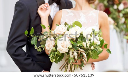 Wedding Couple With Bride Holding Bouquet