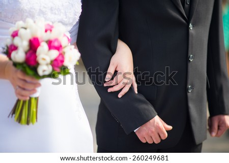 Wedding couple with hands on and flower