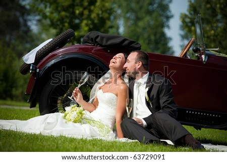 wedding couple with wedding car - stock photo