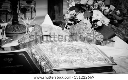 Wedding crowns and bible prepared for ceremony - stock photo