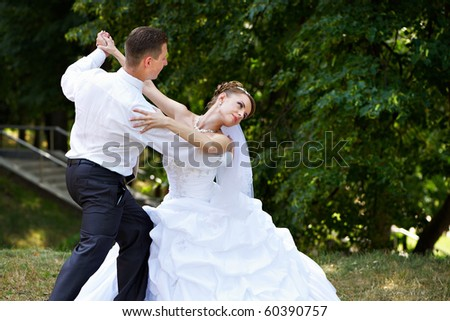 Wedding dance the bride and groom in park - stock photo