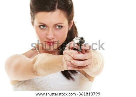 Wedding Day. Angry betrayed bride concept. Woman in white dress with gun isolated on white. Studio shot. - stock photo