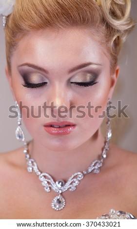 Wedding day bridal make up, close up shot  - stock photo
