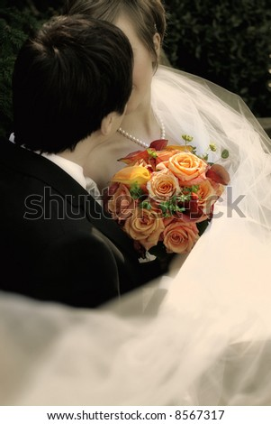 wedding day - Bride and groom kissing - stock photo