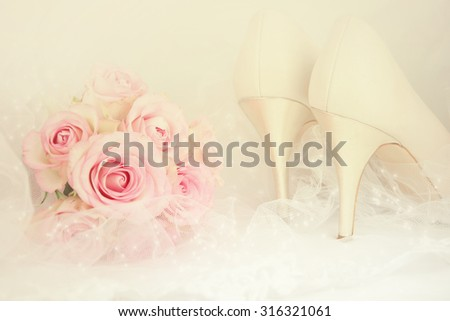 Wedding Day concept with roses and bridal shoes. - stock photo