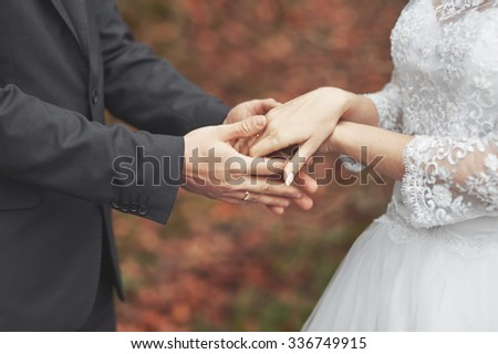 Wedding day. Hands of newlywed couple together.  - stock photo
